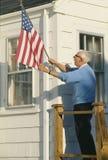 Elderly Man Raising American Flag Royalty Free Stock Photo