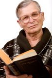 Elderly man reading a book Stock Photography