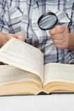 Elderly man reading a book Stock Photos