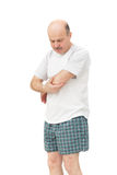 Elderly man received a wrist injury while playing sports. Pain from arthritis and arthrosis royalty free stock image