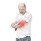 Elderly man received a wrist injury while playing sports. Pain from arthritis and arthrosis stock photo