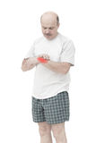 Elderly man received a wrist injury while playing sports. Pain from arthritis and arthrosis stock images