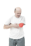 Elderly man received a wrist injury while playing sports. Pain from arthritis and arthrosis royalty free stock photo