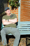 Elderly man relaxing on bench. Royalty Free Stock Photography