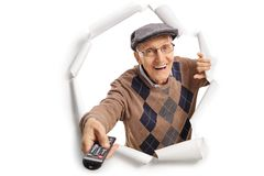 Elderly man with a remote control stock images