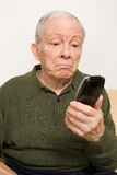 Elderly man with remote control. Elderly men with remote control Stock Image