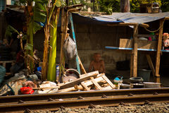 Elderly man resident of the train track slums of central Jakarta Royalty Free Stock Image