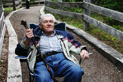 Elderly man resting. In a chair Stock Images
