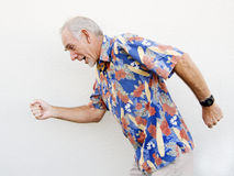 Elderly man running past Royalty Free Stock Photos