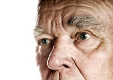 Elderly man's face. Over white background royalty free stock image
