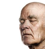 Elderly man's face. Over white background royalty free stock photos