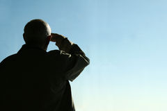 Elderly Man Saluting Royalty Free Stock Photo