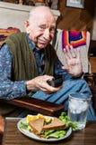 Elderly Man with Sandwich Royalty Free Stock Photo