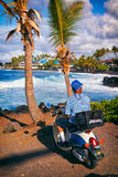 Elderly man on scooter viewing Kona coast, Big Island Hawaii, USA stock photos