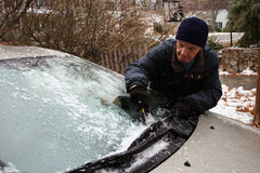 Elderly man scraping windshield Stock Photo