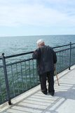 Elderly man by the sea Stock Photos