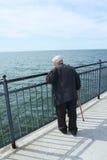 Elderly man by the sea stock photos