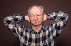 Elderly man with serious expression Stock Photo