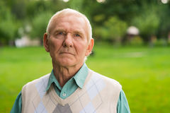 Elderly man with serious face. Stock Photography