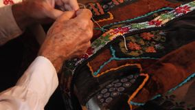 Elderly man sew stock video