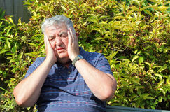 Elderly man shocked and stressed. Royalty Free Stock Photography