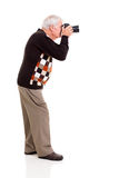 Elderly man shooting Royalty Free Stock Images