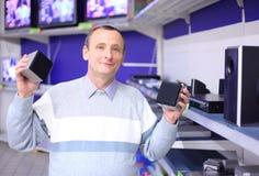Elderly man in shop of radio engineering Royalty Free Stock Photo