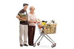 Elderly man with shopping bag and woman with shopping cart Stock Images