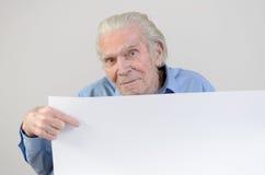 Elderly man showing a blank whiteboard Royalty Free Stock Photo