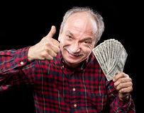 Elderly man showing fan of money Stock Image