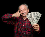 Elderly man showing fan of money Stock Photos