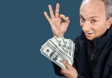 Elderly man showing fan of money Stock Photos