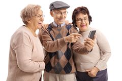 Elderly man showing something on a phone to two elderly women Stock Photography