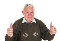 Elderly man showing thumbs up Royalty Free Stock Images
