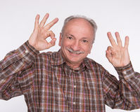 Elderly man shows ok sigh Stock Images