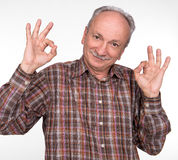 Elderly man shows ok sigh Stock Photo