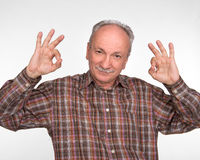 Elderly man shows ok sigh Stock Photos