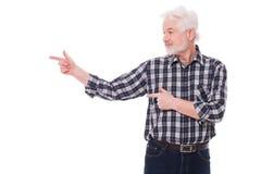 Elderly man shows on something Royalty Free Stock Image