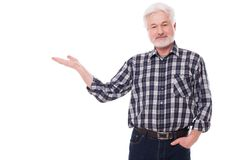Elderly man shows on something Stock Photo
