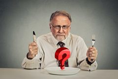 Senior perplexed man choosing meal stock images