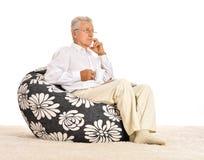 Elderly man sitting Royalty Free Stock Image