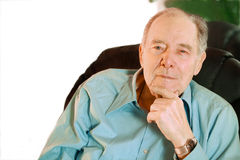 Elderly man sitting in chair , thinking Stock Images