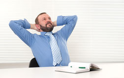 Man sitting in his office Stock Photos