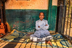 Elderly man sitting in the street of Kathmandu, Nepal Royalty Free Stock Image