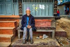 Elderly man sitting in the street of Kathmandu, Nepal Stock Photos