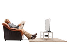 Elderly man sleeping in front of the TV Royalty Free Stock Images