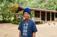 Elderly man with smiley face living in taditional thai village with farmstay Royalty Free Stock Images