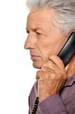 Elderly man speaking on phone Stock Photo