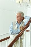 Elderly man on stairs Stock Photos