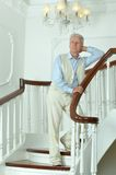 Elderly man on stairs Royalty Free Stock Photo
